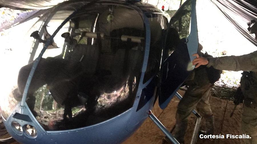 Helicóptero tipo Robinson R44 en el que encontraron 330 kilogramos de clorhidrato de cocaína que estaban distribuidos en 9 bultos.